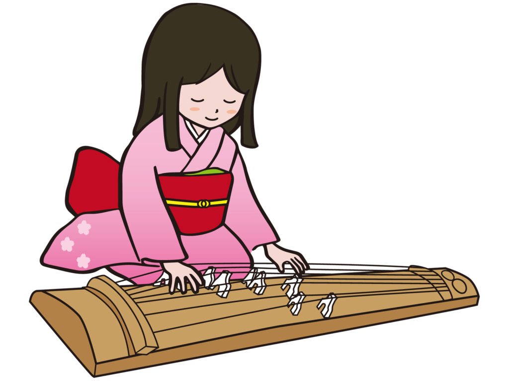 箏(琴)を弾く女性