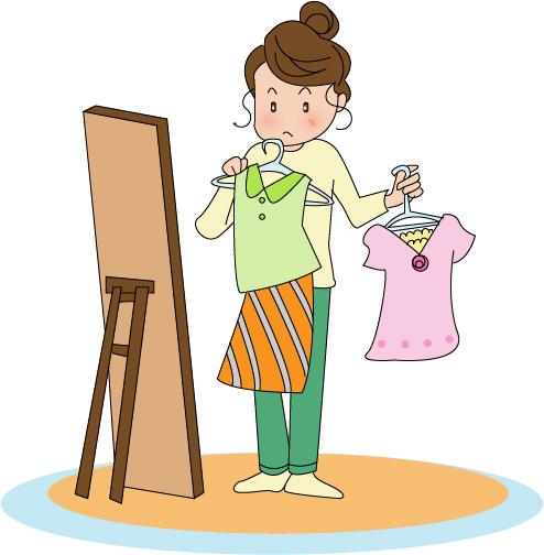 自分の服をコーディネートする女性